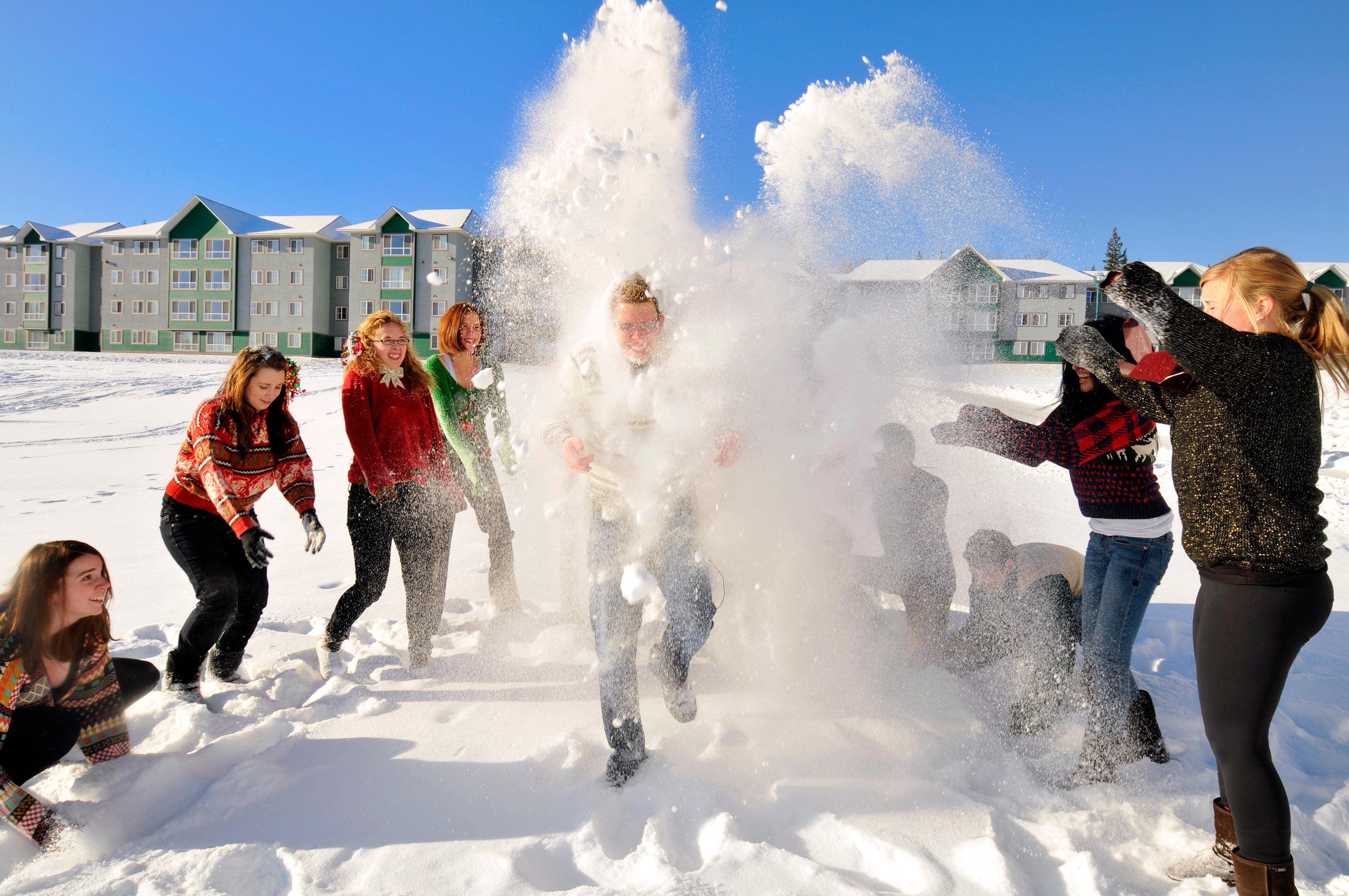 UNBC students throwing snow at each other on campus in Prince George, BC.